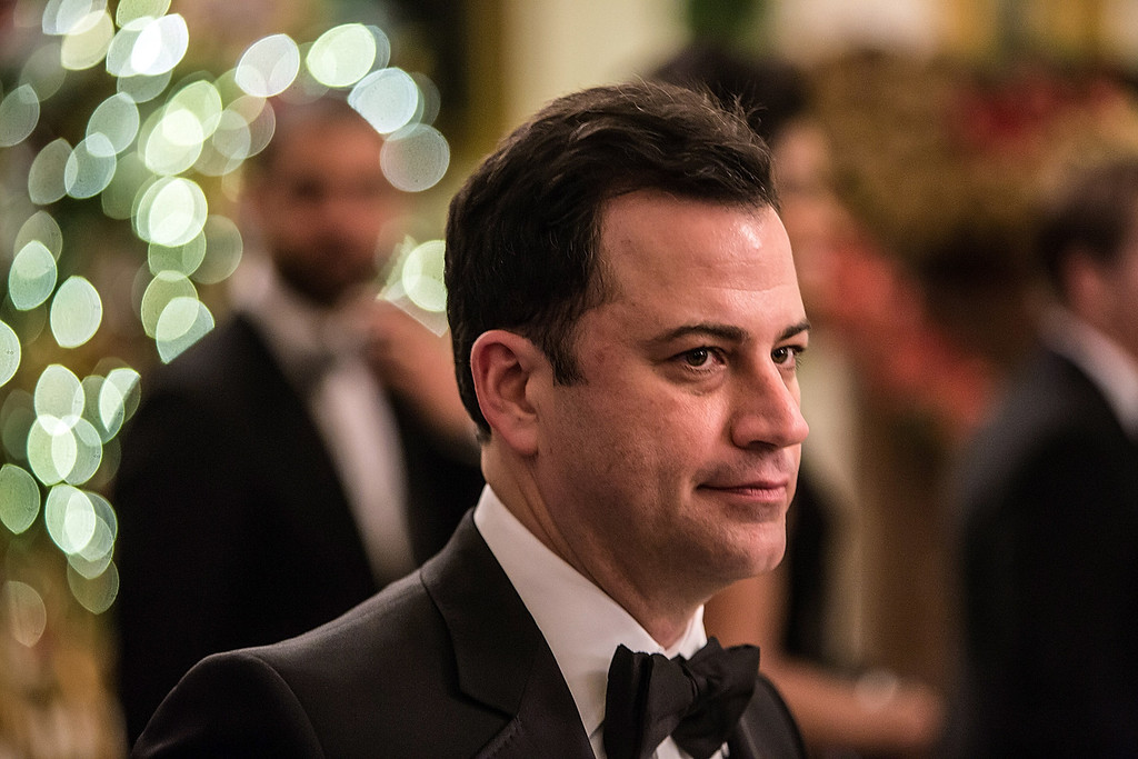 Description of . WASHINGTON - DECEMBER 2: (AFP OUT) Comedian Jimmy Kimmel departs the Kennedy Center Honors reception at the White House on December 2, 2012 in Washington, DC. The Kennedy Center Honors recognized seven individuals - Buddy Guy, Dustin Hoffman, David Letterman, Natalia Makarova, John Paul Jones, Jimmy Page, and Robert Plant - for their lifetime contributions to American culture through the performing arts. (Photo by Brendan Hoffman/Getty Images)