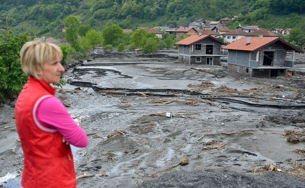 Description of . A resident overlooks the damage done by a landslide at the village of Topcic Polje, near the Bosnian town of Zenica, 90 kilometers north of Sarajevo, Bosnia-Herzegovina Tuesday May 20, 2014.  (AP Photo/Sulejman Omerbasic)
