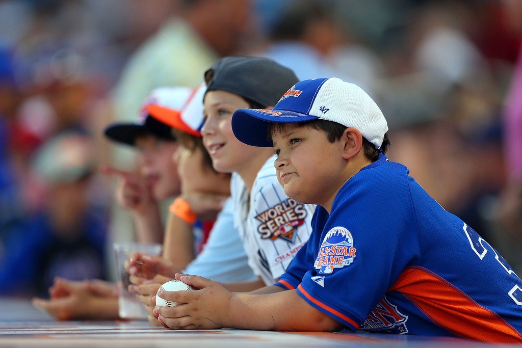 Description of . Young fans wait for autographs during the 84th MLB All-Star Game on July 16, 2013 at Citi Field in the Flushing neighborhood of the Queens borough of New York City.  (Photo by Mike Ehrmann/Getty Images)