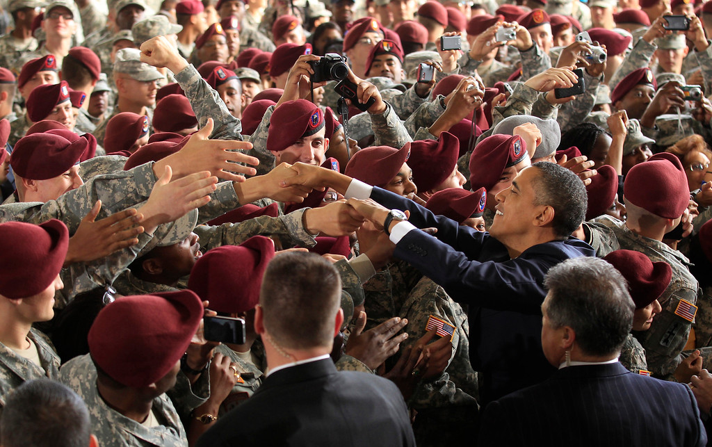 Description of . U.S. President Barack Obama greets troops at Fort Bragg in North Carolina December 14, 2011. The visit was seen as marking the end of the Iraq war with a tribute to the troops who fought and died in a conflict Obama opposed from the start. REUTERS/Kevin Lamarque