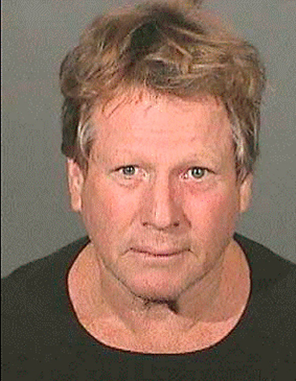 Description of . In this image released by the Los Angeles County Sheriffs Department, actor Ryan O'Neal  is shown in an arrest photo on Wednesday, Sept. 17, 2008 in Los Angeles.  O'Neal and his son Redmond were arrested Wednesday morning after authorities said a check of their Malibu home turned up drugs. Los Angeles Sheriff's deputies and probation officers went to O'Neal's home to check on his son Redmond, who is serving three years of probation after pleading guilty in June to drug possession charges. (AP Photo/Los Angeles County Sheriffs Department)