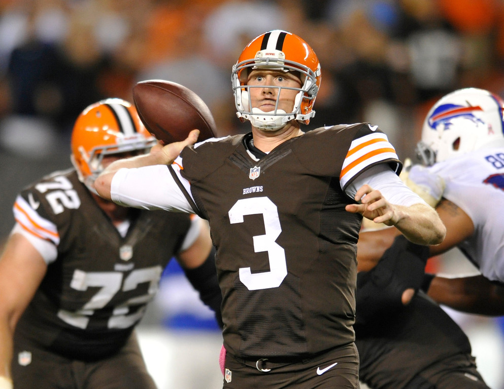 Description of . Cleveland Browns quarterback Brandon Weeden passes against the Buffalo Bills in the fourth quarter of an NFL football game Thursday, Oct. 3, 2013, in Cleveland. Weeden took over for starter Brian Hoyer who was injured in the first quarter. (AP Photo/David Richard)