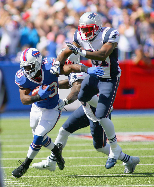 Description of . C.J. Spiller #28 of the Buffalo Bills runs against  Aqib Talib #31 of the New England Patriots at Ralph Wilson Stadium on September 8, 2013 in Orchard Park, New York.  (Photo by Rick Stewart/Getty Images)