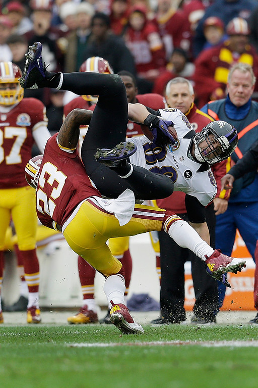 Description of . LANDOVER, MD - DECEMBER 09: Tight end Dennis Pitta #88 of the Baltimore Ravens is tackled by cornerback DeAngelo Hall #23 of the Washington Redskins after catching a first half pass at FedExField on December 9, 2012 in Landover, Maryland.  (Photo by Rob Carr/Getty Images)
