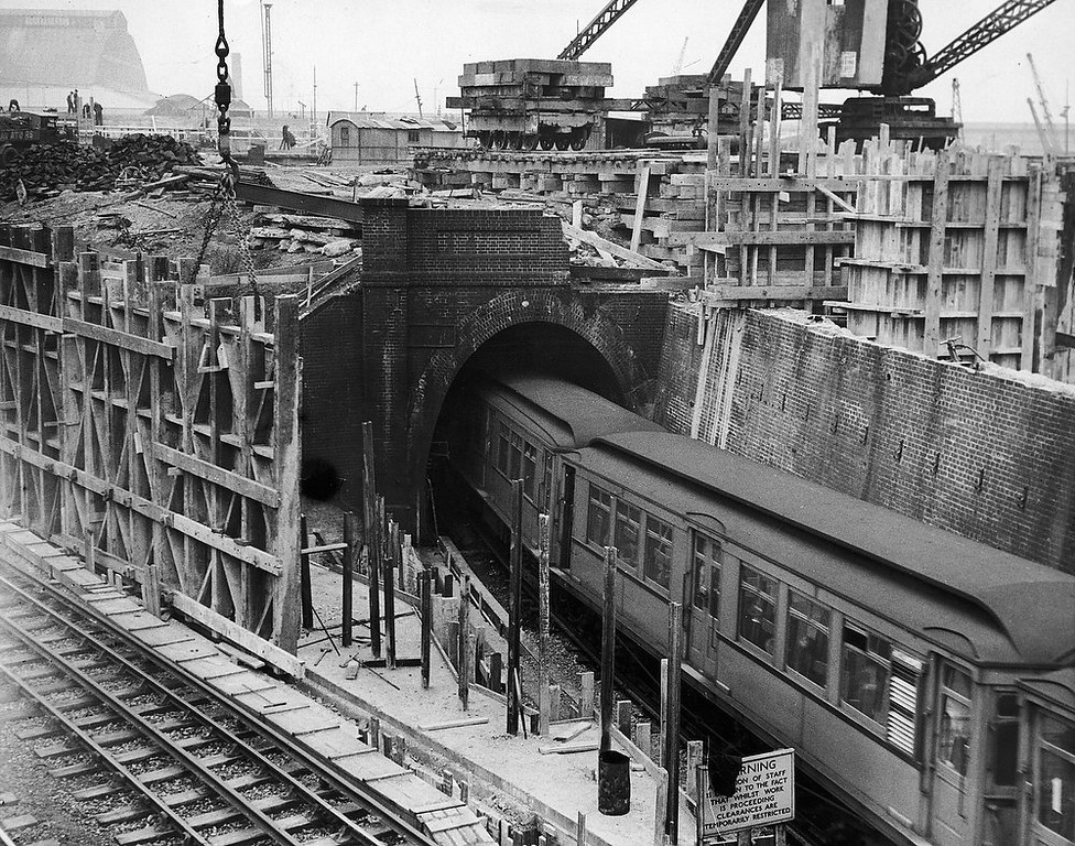 Description of . Six underground railway tunnels run under the Earl\'s Court Exhibition building which is under construction near Earl\'s Court Station, London on May 1, 1936. The new Exhibition building has been leased for the 1937 British Industries Fair.  (Photo by Harry Shepherd/Fox Photos/Getty Images)