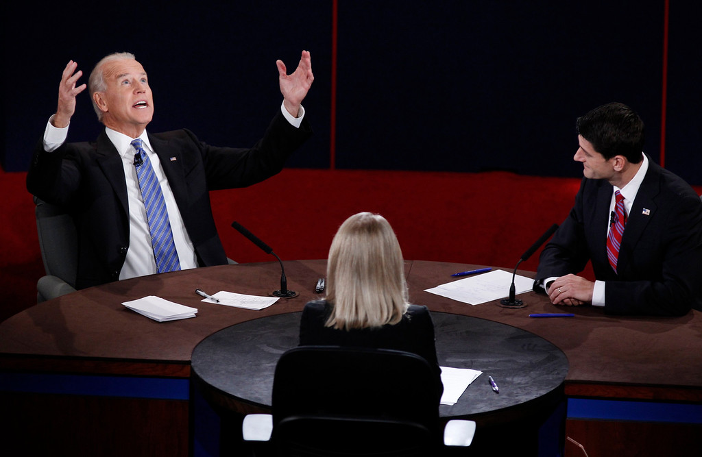 Description of . U.S. Vice President Joe Biden (L) makes a point in front of Republican vice presidential nominee Paul Ryan and moderator Martha Raddatz (C) during the vice presidential debate in Danville, Kentucky, October 11, 2012.  REUTERS/Jeff Haynes