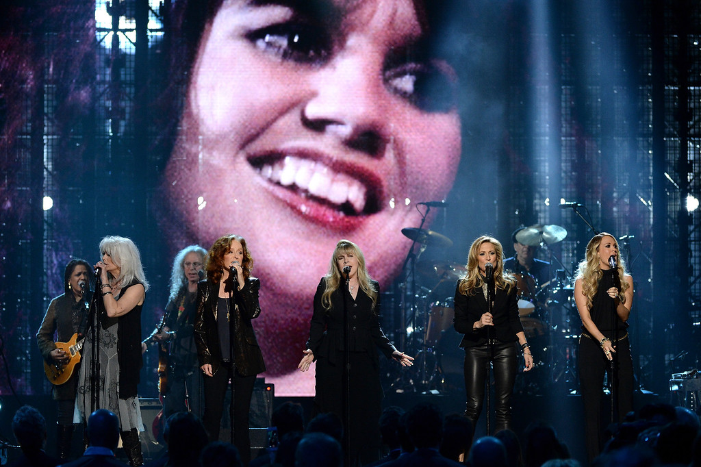 Description of . (L-R) Emmylou Harris, Bonnie Raitt, Stevie Nicks, Sheryl Crow and Carrie Underwood perform onstage at the 29th Annual Rock And Roll Hall Of Fame Induction Ceremony at Barclays Center of Brooklyn on April 10, 2014 in New York City.  (Photo by Larry Busacca/Getty Images)