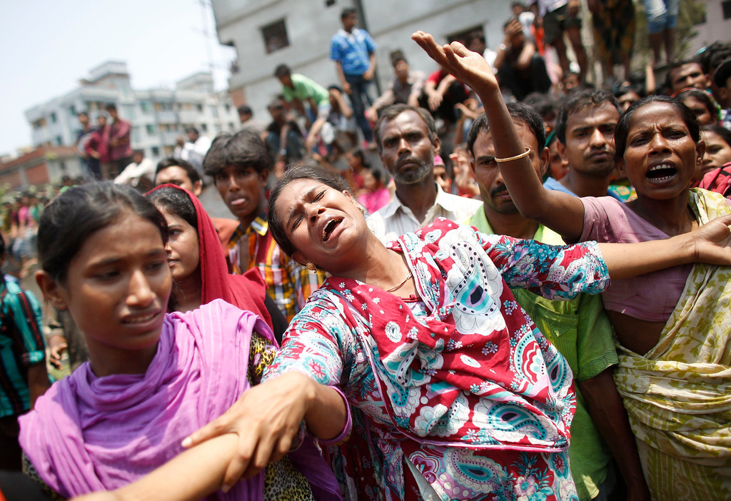 Description of . People mourn for their relatives, who were working in the Rana Plaza building when it collapsed, in Savar, 30 km (19 miles) outside Dhaka April 24, 2013. REUTERS/Andrew Biraj