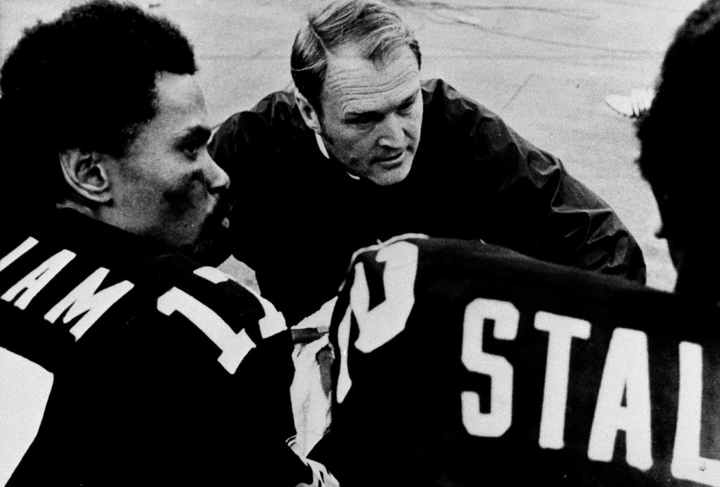 Description of . Steelers coach Chuck Noll confers with quarterback Joe Gilliam, left, and wide receiver John Stallworth during Sunday, Sept. 29, 1975 game to Buffalo. Steelers lost 30-21 to the Buffalo Bills. (AP Photo)