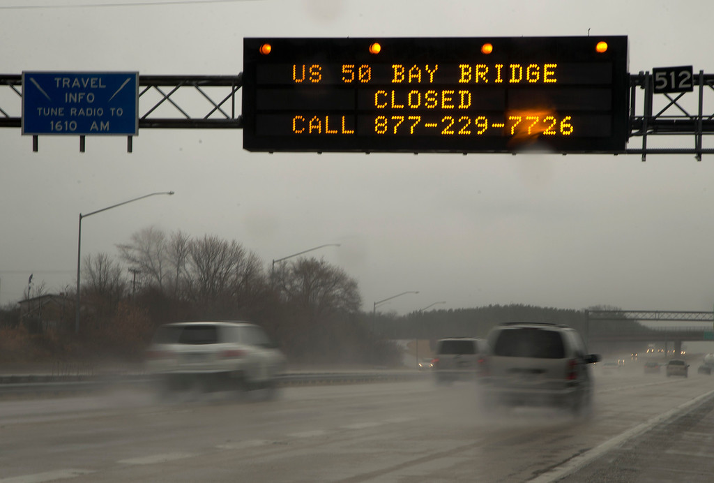 Description of . A sign spanning I 97 South in Millersville, Md., Wednesday, March 6, 2013.,  alerts travelers that the Chesapeake Bay Bridge is closed in both directions.  Maryland's Bay Bridge was closed Wednesday afternoon in both directions due to high winds from a snowstorm blowing through the Mid-Atlantic region.  (AP Photo/Carolyn Kaster)