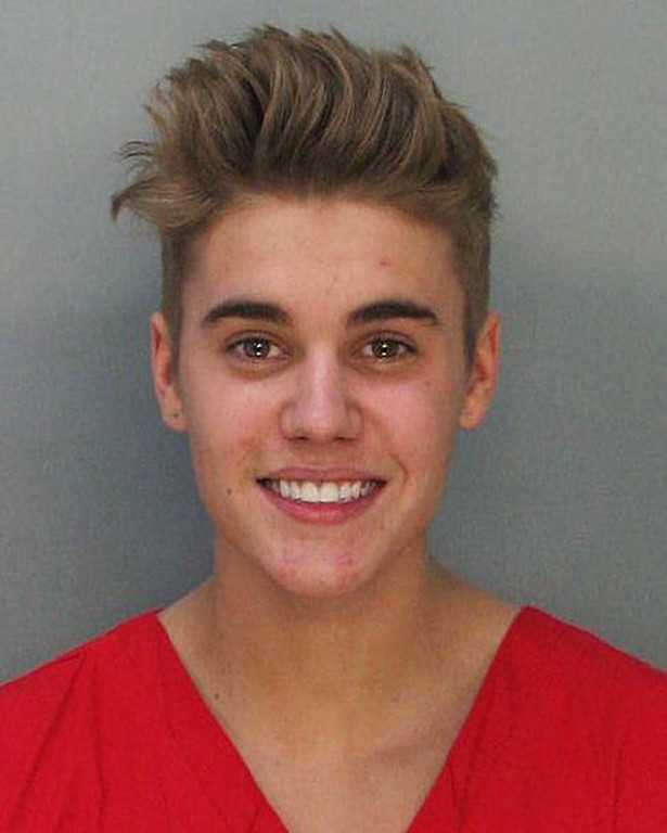 . This police booking mug made available by the Miami Dade County Corrections Department shows pop star Justin Bieber, Thursday, Jan. 23, 2014. Bieber  and R7B singer Khalil were arrested for allegedly drag-racing on a Miami Beach Street. Police say Bieber has been charged with resisting arrest without violence in addition to drag racing and DUI. Police also say the singer told authorities he had consumed alcohol, smoked marijuana and taken prescription drugs. (AP Photo/Miami Dade County Jail)