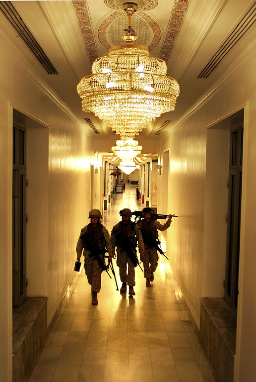 Description of . Members of the U.S. Marine Security Force walk through the halls of the U.S. Embassy February  6, 2007 in Baghdad, Iraq . The platoon of Marines from the Anti-Terrorism Battalion was tasked with defending the exterior of U.S. diplomatic mission against attacks in one of the most dangerous cities in the world. (Photo by John Moore/Getty Images)