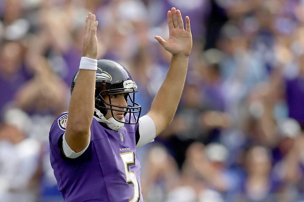 Description of . Baltimore Ravens quarterback Joe Flacco celebrates running back Bernard Pierce's touchdown during the second half of an NFL football game against the Cleveland Browns in Baltimore, Md., Sunday, Sept. 15, 2013. (AP Photo/Patrick Semansky)