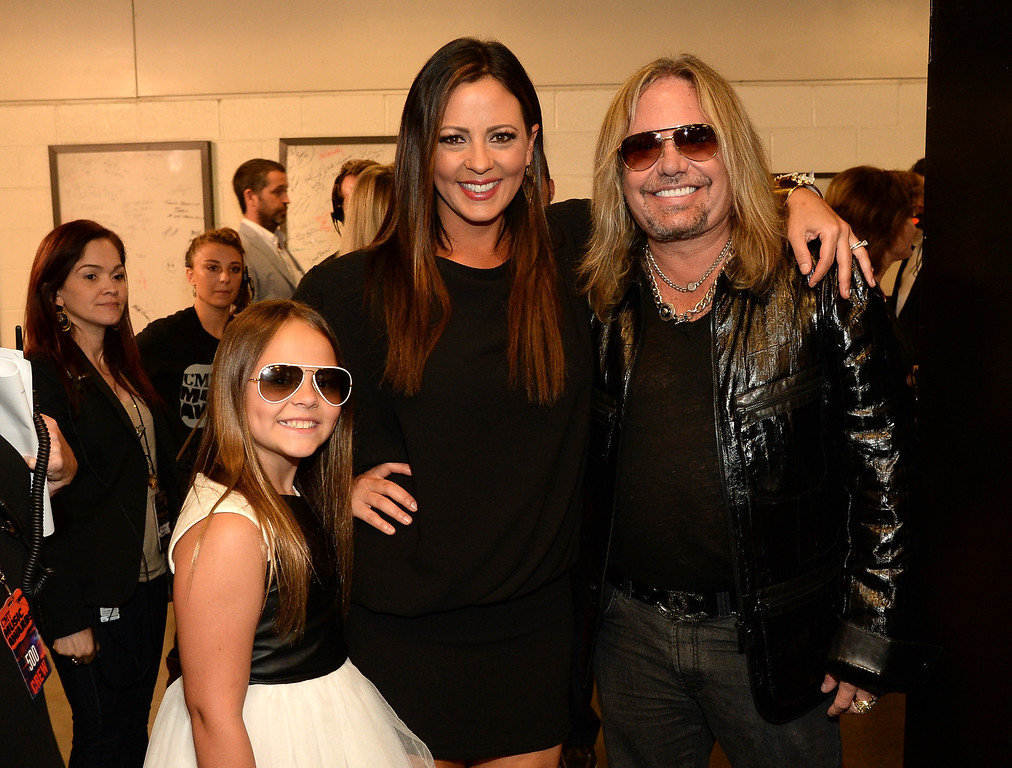 Description of . Aubrey Evans, Sara Evans and Vince Neil attend the 2014 CMT Music Awards at Bridgestone Arena on June 4, 2014 in Nashville, Tennessee.  (Photo by Rick Diamond/Getty Images for CMT)