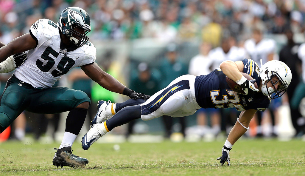 Description of . San Diego Chargers' Danny Woodhead, right, dives for extra yardage past Philadelphia Eagles' DeMeco Ryans during the second half of an NFL football game, Sunday, Sept. 15, 2013, in Philadelphia. San Diego won 33-30. (AP Photo/Matt Rourke)