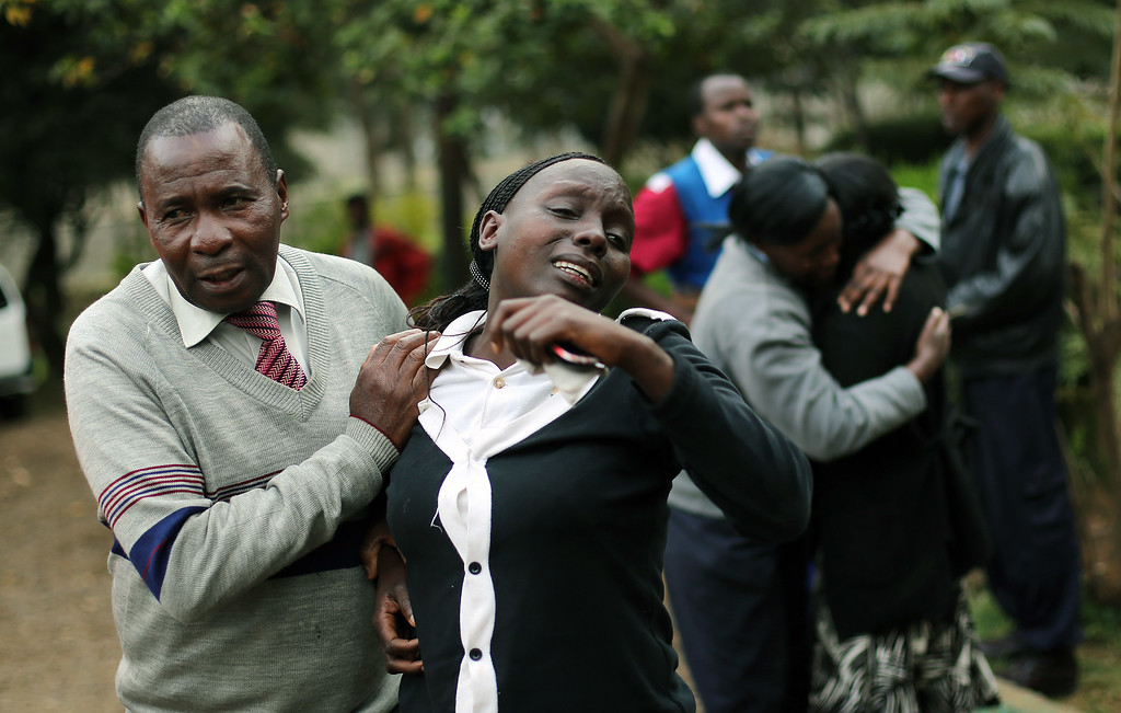 Description of . Relatives of Johnny Mutinda Musango, 48, weep after identifying his body at the city morgue  in Nairobi, Kenya Tuesday Sept. 24 2013. Musango was one of the victims of the Westgate Mall hostage siege. Kenyan security forces were still combing the Mall on the fourth day of the siege by al-Qaida-linked terrorists. (AP Photo/ Jerome Delay)