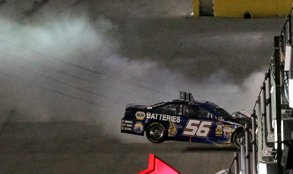 Description of . Martin Truex Jr. hits the wall after he was involved in a wreck coming out of Turn 4 during the NASCAR Sprint Cup auto race at Daytona International Speedway, Saturday, July 6, 2013, in Daytona Beach, Fla. (AP Photo/David Graham)