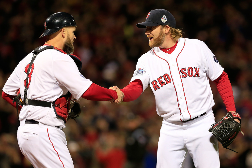 Description of . Ryan Dempster #46 and David Ross #3 of the Boston Red Sox celebrate after defeating the St. Louis Cardinals 8-1 in Game One of the 2013 World Series at Fenway Park on October 23, 2013 in Boston, Massachusetts.  (Photo by Jamie Squire/Getty Images)
