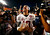 Alabama Crimson Tide quarterback AJ McCarron celebrates with the trophy after his team defeated the Notre Dame Fighting Irish in their NCAA BCS National Championship college football game in Miami, Florida, January 7, 2013.  REUTERS/Chris Keane