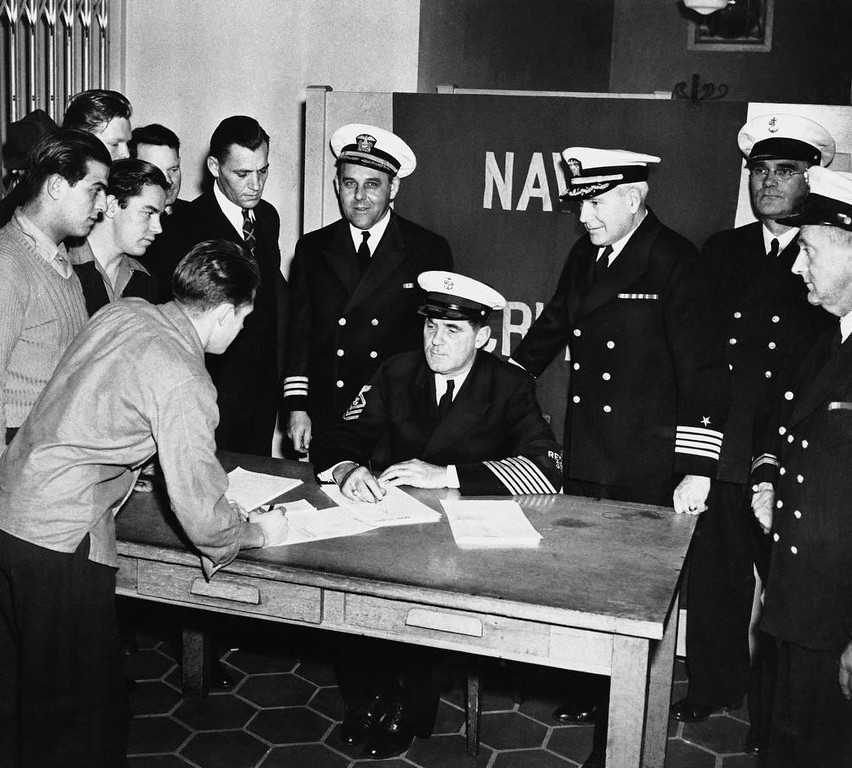 Description of . A crowd of young men enlist in the Navy in San Francisco, Calif., Dec. 7, 1941, at the Federal Office Building.  (AP Photo)
