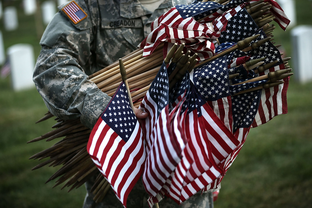 """Description of . A member of the Fife and Drum Corps of the 3rd U.S. Infantry Regiment, \""""The Old Guard,\"""" participate in a \""""Flags-In\"""" ceremony May 23, 2013 at Arlington National Cemetery in Arlington, Virginia.   (Photo by Alex Wong/Getty Images)"""