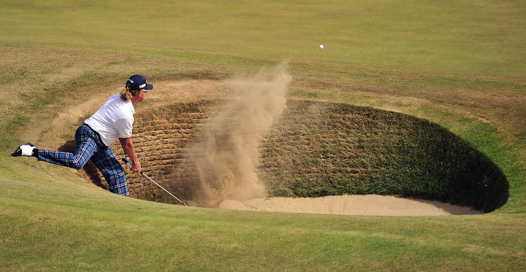 Description of . Spain's Miguel Angel Jimenez plays a shot out of a bunker on the fourth during the third round of the 2013 British Open Golf Championship at Muirfield golf course at Gullane in Scotland on July 20, 2013.  GLYN KIRK/AFP/Getty Images