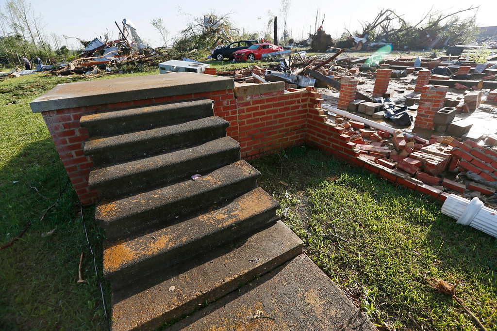 Description of . A set of front door steps are all that remain of a house that was blown off its foundation by Monday's tornado in Louisville, Miss., Tuesday, April 29, 2014.  (AP Photo/Rogelio V. Solis)