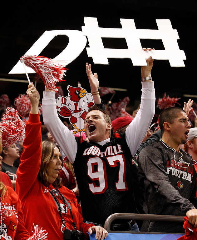 Description of . Louisville fans react in the first half of the Sugar Bowl NCAA college football game against Florida on Wednesday, Jan. 2, 2013, in New Orleans. (AP Photo/Bill Haber)