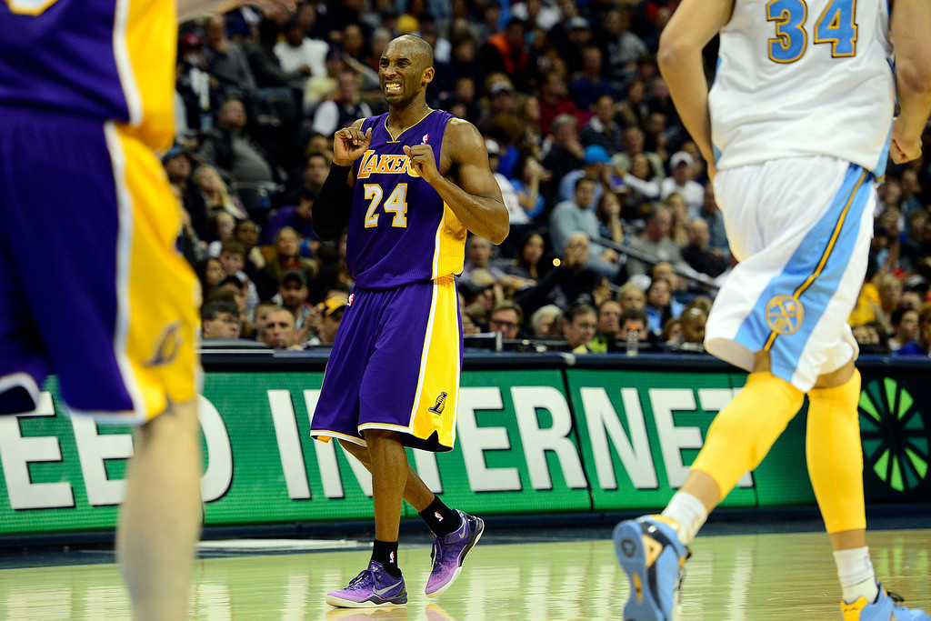 Description of . Los Angeles Lakers shooting guard Kobe Bryant (24) reacts a turnover against the Denver Nuggets during the second half of the Nuggets' 126-114 win at the Pepsi Center on Wednesday, December 26, 2012. AAron Ontiveroz, The Denver Post