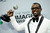 Lance Gross poses backstage with the award for outstanding supporting actor in a comedy series for