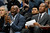 Sacramento Kings head coach Keith Smart, left, directs his team as assistant coach Alex English looks on in the fourth quarter of the Denver Nuggets' 121-93 victory over the Kings in an NBA basketball game in Denver on Saturday, Jan. 26, 2013. (AP Photo/David Zalubowski)