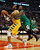 Chicago Bulls' Nate Robinson (R) grabs Denver Nuggets' Andre Iguodala as he fouls him during the first half of their NBA basketball game in Chicago, Illinois, March 18, 2013. REUTERS/Jim Young
