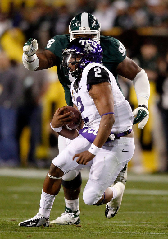 Description of . TCU quarterback Trevone Boykin (2) carries the ball during the first quarter of the Buffalo Wild Wings Bowl NCAA college football game against Michigan State, Saturday, Dec. 29, 2012, in Tempe, Ariz. (AP Photo/The Arizona Republic, Cheryl Evans)