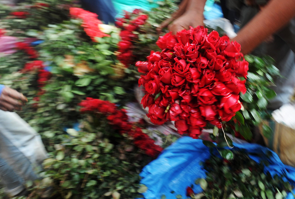 Description of . Indian farmers wait for customers at a wholesale flower market in Kolkata, on February 14, 2013. On Valentine's day the floriculture business in the city is booming because of the increased demand nationally. AFP PHOTO/ Dibyangshu  SARKAR/AFP/Getty Images