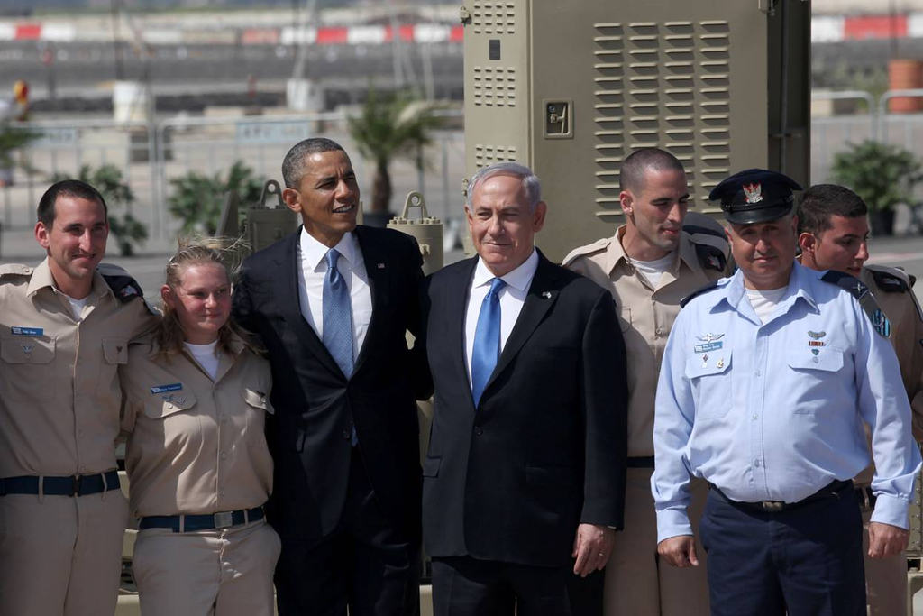 Description of . U.S. President Barack Obama (3L) is greeted by Israeli Prime Minister Benjamin Netanyahu (C) during an official welcoming ceremony on his arrival at Ben Gurion International Airport on March, 20, 2013 near Tel Aviv, Israel. (Photo by Marc Israel Sellem-Pool/Getty Images)