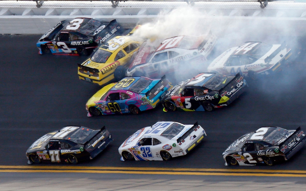 Description of . NASCAR drivers crash in an eleven car pile-up late in the NASCAR Nationwide Series DRIVE4COPD 300 race at the Daytona International Speedway in Daytona Beach, Florida February 23, 2013. The Daytona 500 NASCAR Sprint Cup race is scheduled for February 24. REUTERS/Pierre Ducharme