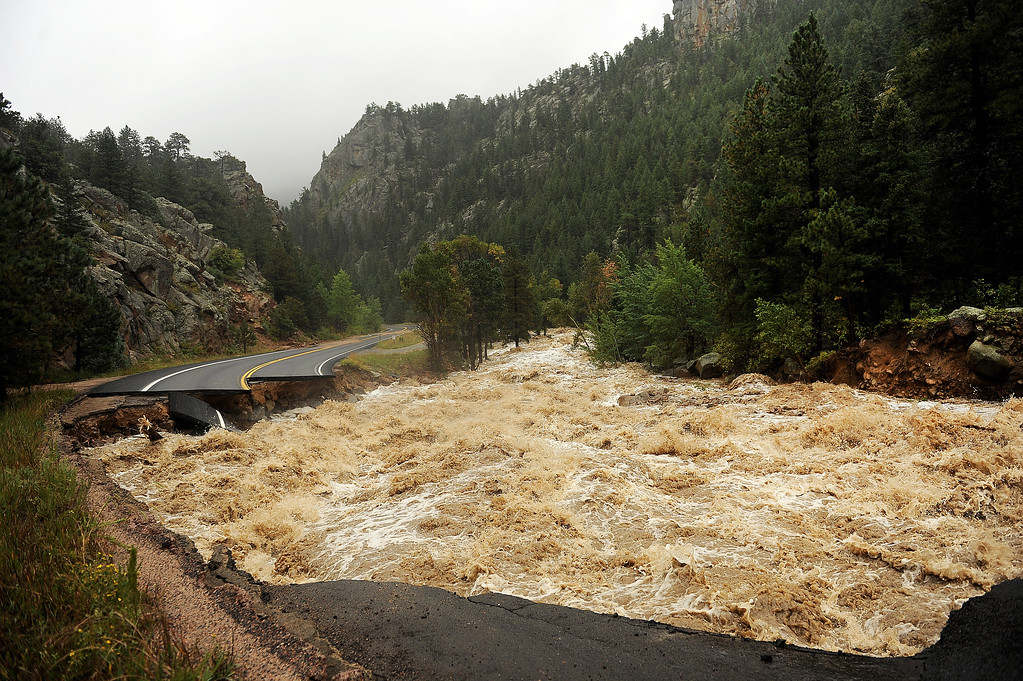 Description of . NEAR LYONS , CO - SEPTEMBER 12: Hwy 7 is completely blown out from the  South St. Vrain river as a torrent of raging water rips through it about 12 miles west of Lyons, Colo. along Highway 7 on September 12, 2013. Heavy and continuous rains have created devastating and major flooding in many mountain communities. Some areas have had over 10 inches of rain in the last 24-48 hours.  (Photo By Helen H. Richardson/ The Denver Post)