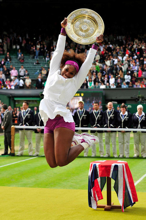 Description of . US player Serena Williams celebrates with the trophy, the Venus Rosewater Dish after her women's singles final victory over Poland's Agnieszka Radwanska on day 12 of the 2012 Wimbledon Championships tennis tournament at the All England Tennis Club in Wimbledon, southwest London, on July 7, 2012. Serena Williams won the match 6-1, 5-7, 6-2. AFP PHOTO/ GLYN KIRK  /AFP/Getty Images