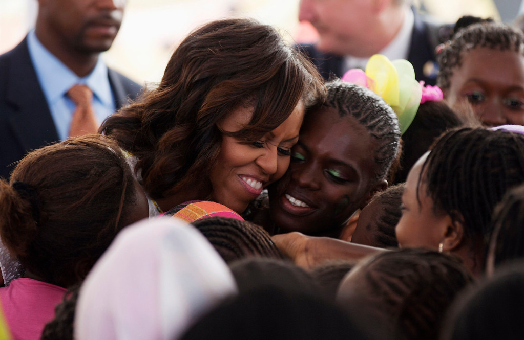 Description of . U.S.first lady Michelle Obama hugs students at Martin Luther King middle school, an all-girls school in Dakar, Senegal June 27 2013. U.S. President Barack Obama Obama and his wife Michelle are visiting Senegal until June 28 before travelling to South Africa and Tanzania.  REUTERS/Joe Penney