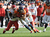 Denver Broncos wide receiver Eric Decker (87) is tackled by Kansas City Chiefs cornerback Brandon Flowers (24) and Kansas City Chiefs strong safety Eric Berry (29) in the first quarter as the Denver Broncos took on the Kansas City Chiefs at Sports Authority Field at Mile High in Denver, Colorado on December 30, 2012. Tim Rasmussen, The Denver Post