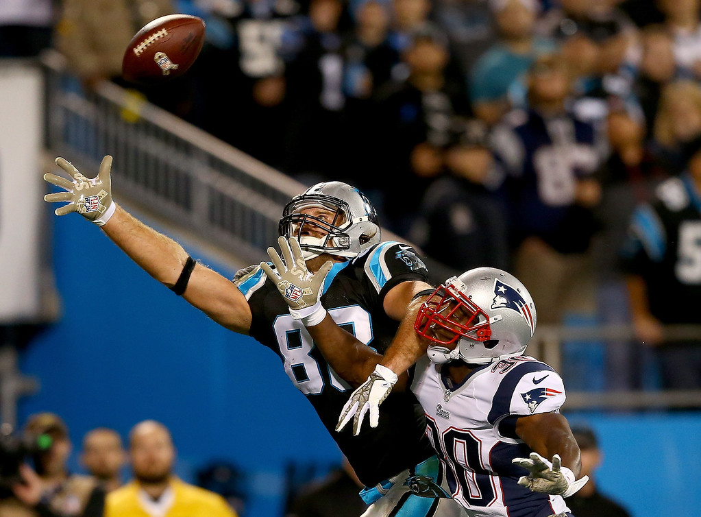 . Tight end Greg Olsen #88 of the Carolina Panthers goes up for a catch against defensive back Duron Harmon #30 of the New England Patriots in the first half at Bank of America Stadium on November 18, 2013 in Charlotte, North Carolina.  (Photo by Streeter Lecka/Getty Images)