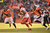 Kansas City Chiefs running back Jamaal Charles (25) makes a run in the first quarter as Denver Broncos free safety Rahim Moore (26) and Denver Broncos cornerback Chris Harris (25) pursue as the Denver Broncos took on the Kansas City Chiefs at Sports Authority Field at Mile High in Denver, Colorado on December 30, 2012. John Leyba, The Denver Post