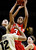 Utah's Iwalani Rodrigues (3) grabs for a rebound against Colorado's Ashley Wilson (12) during the second half of their NCAA college basketball game, Tuesday, Jan. 8, 2013, in Boulder, Colo. Colorado won 67-57. (AP Photo/Brennan Linsley)