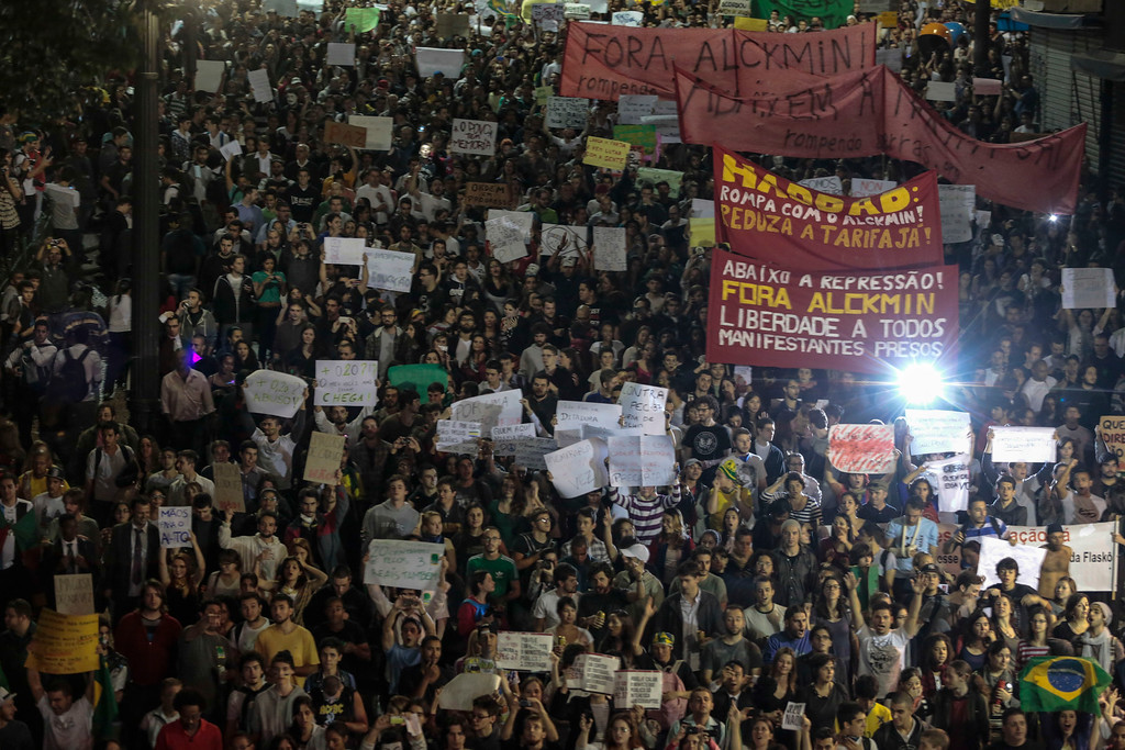 Description of . Students gather during a demonstration in front of the City Hall in Sao Paulo, Brazil on June 18, 2013, against a recent rise in public bus and subway fare from 3 to 3.20 reais (1.50 USD).  President Dilma Rousseff vowed Tuesday to listen to youths staging Brazil's biggest protests in 20 years in an outpouring of anger over the huge cost of staging events like the World Cup.   Miguel Schincariol/AFP/Getty Images