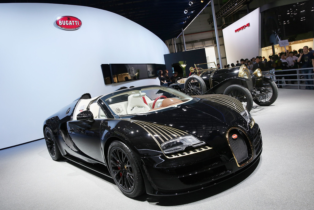 Description of . A Bugatti vehicle is displayed during the 2014 Beijing International Automotive Exhibition at China International Exhibition Center on April 21, 2014 in Beijing, China.  (Photo by Feng Li/Getty Images)