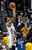 Denver Nuggets guard Wilson Chandler, left, shoots over Minnesota Timberwolves forward Derrick Williams (7) in the first quarter of an NBA basketball game on Saturday, March 9, 2013, in Denver. (AP Photo/Chris Schneider)