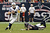Andrew Luck #12 of the Indianapolis Colts avoids the tackle by J.J. Watt #99 of the Houston Texans in the second half at Reliant Stadium on December 16, 2012 in Houston, Texas. Texans win 29-17 to clinch the AFC South. (Photo by Bob Levey/Getty Images)