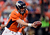 Denver Broncos quarterback Peyton Manning #18 hands off during the second quarter.  The Denver Broncos vs The Tampa Bay Buccaneers at Sports Authority Field Sunday December 2, 2012. John Leyba, The Denver Post