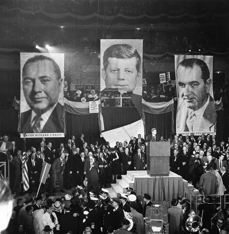Description of . Kennedy speaks to supporters as he stands with his sister, Eunice Shriver, looking back, Chicago Mayor Richard J. Daley, center, and Otto Kerner, Democratic candidate for Illinois governor, at Chicago Stadium in Chicago.   Associated Press file, File