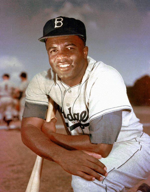 Description of . 1952 photo of Brooklyn Dodgers Jackie Robinson. Jackie Robinson broke baseball\'s color barrier. (AP PHOTO)